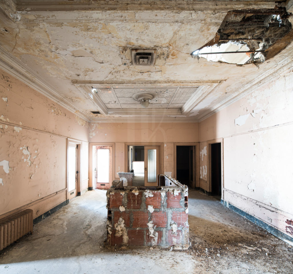 Much of the interior has rotted away, with patches of floor and roof missing.