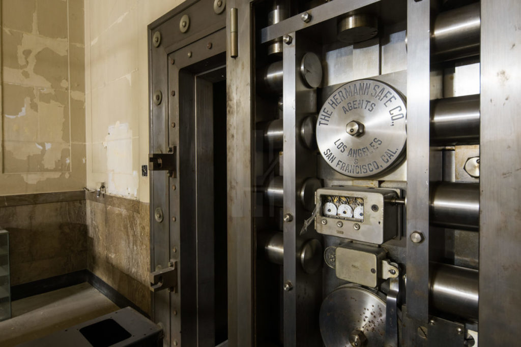 A heavy vault door remains, used first by the Coast Federal Savings Bank and later by the Home Savings and Loan Assn.